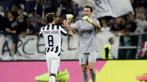 Claudio Marchisio y Gianluigi Buffon.