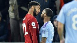 Raheem Sterling se carea con Joe Gómez.